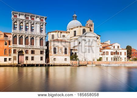 Venice - January 2017, Veneto, Italy: The street of Venice, old houses and San Geremia church (Chiesa di San Geremia e Lucia) reflected in the water of Grand Canal, famous landmark in the city