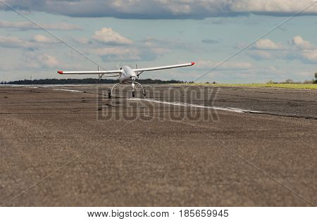 Unmanned aerial vehicle (UAV) starts from the asphalt runway.