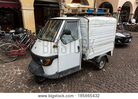 PADUA ITALY - MAY 3 2016: Piaggio Ape50 in Rome. Piaggio Ape is a three-wheeled light commercial vehicle first produced in 1948 by Piaggio. Padua Italy