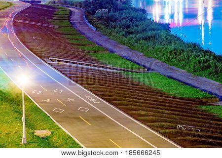 Taipei riverside park cycling path at night