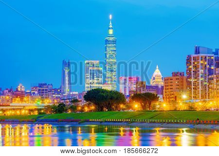 TAIPEI TAIWAN - APRIL 05: This is a view of the Xinyi financial district and Taipei 101 building with the keelung river at night on April 05 2017 in Taipei