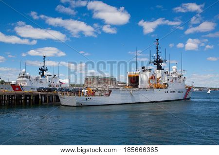 Boston Massachusetts USA - July 7 2016 : United States Coast Guard ships docked in Boston Harbor