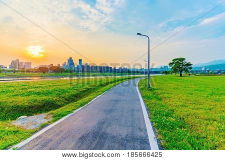 Riverside park with sunset in Taipei during sunset poster