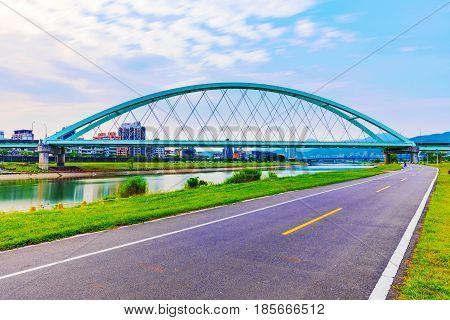 View of Crescent bridge riverside cycling path