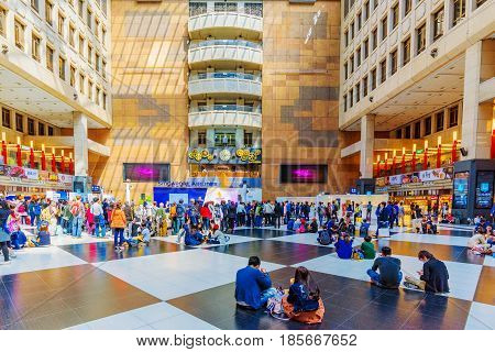 TAIPEI TAIWAN - APRIL 03: People sitting and crowds in the main square inside Taipei main station where many travelers wait on April 03 2017 in Taipei