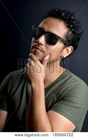 Portrait of Latin man with sunglasses and t-shirt