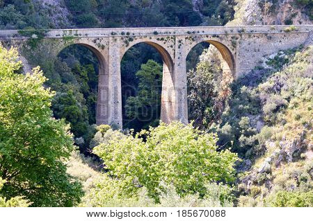 Ancient stone viaduct in the mountains of central Crete