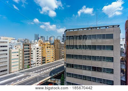 Wide angle view of buildings and road in Japan