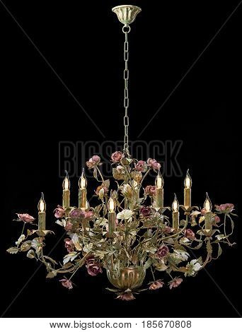 Chandelier classic bronze with curly lampshades flowers and gold leaves. on black background isolated