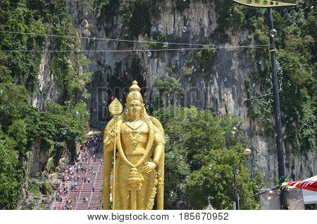 batu caves in malaysia golden statue with soap bubbles