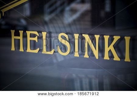 Helsinki golden sign in window in the Finnish capital