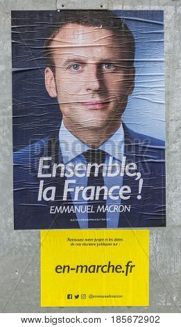 FRANCE - MAY 032017: The electoral poster displaying one of the remaining two French presidential candidates Emmanuel Macron which will compete for the second round on May 7 2017.