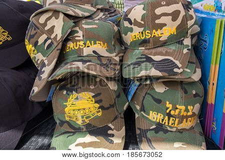 LATRUN ISRAEL - MAY 02 2017: Baseball camouflage military Hats for sale at Latrun Armored Corps Museum
