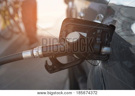 Handle Fuel Nozzle To Refuel