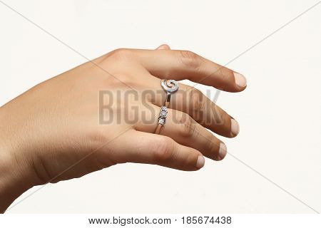 female hand with rings made of white gold with diamonds on a white background