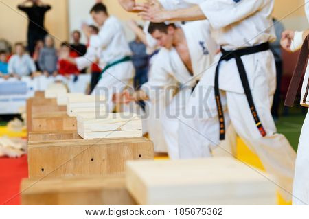 Martial Artists Breaks The Wooden Boards
