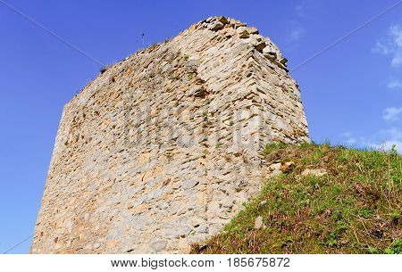 Ruins of fortification (bulwark). Medieval rampart. Closeup.