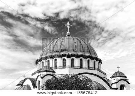 B&W the top of Saint Sava christian catedral with blue cloudy sky in the capital Belgrade