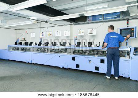 Man Working On A Brochure And Magazine Stitching Process Machine