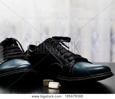 stylish black Male shoes with cuff in wooden background