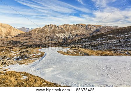 Image of an empty artificial snow ski in Devuloy Massif in the French Alps during the winter.The absence of the snow is a worrying sign for global warming.