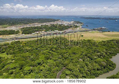 Panoramic aerial view of Gatun Locks with cargo ships passing through Panama Canal