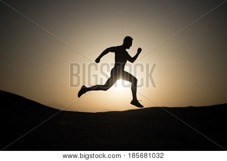 Running Man Silhouette At Sunset Sky