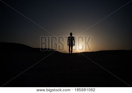 Walking Man Silhouette At Sunset Sky