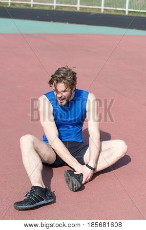 Injured Runner On Running Track Feeling Pain Of Broken Leg