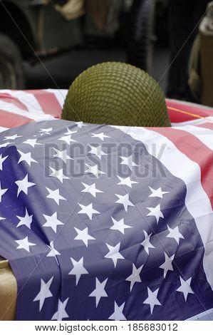 American flag with military helmet World War II