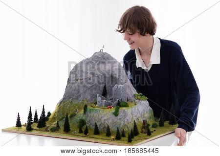 School Student Working On Model Building Project