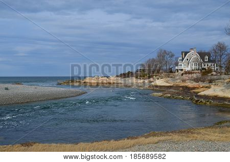 House on coastal inlet in Cohasset Massachusetts.