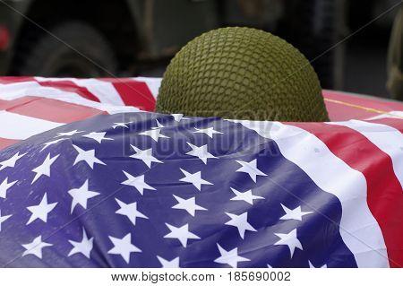 American flag with military helmet memories World War II