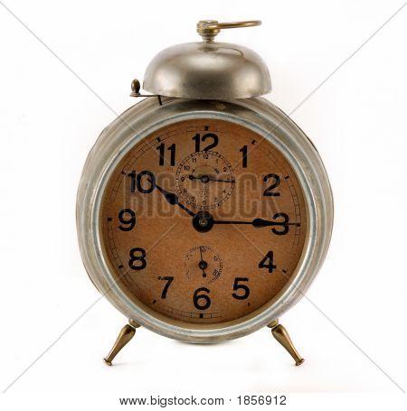 Still working alarm clock against white background. poster