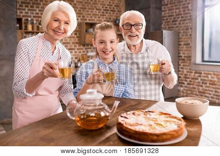 Family Drinking Tea At Home
