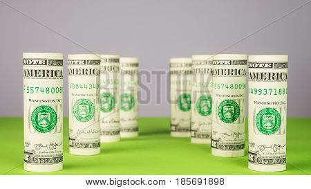 Rolled dollar banknote pillars from dollar money