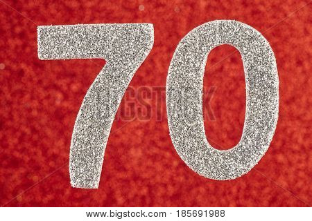 Number seventy silver color over a red background. Anniversary. Horizontal