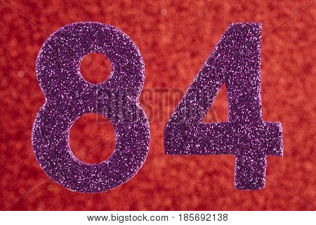 Number eighty-four purple color over a red background. Anniversary. Horizontal