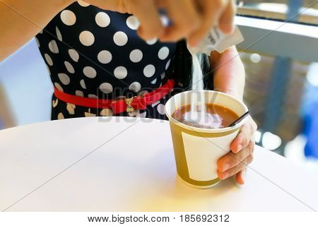 Hand Pouring Unhealthy Non Dairy Creamer From Sachet Into Coffee