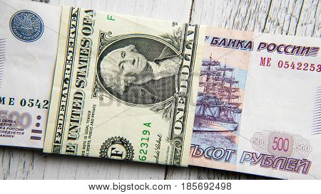 Dollar money versus russian rubles banknotes on the table