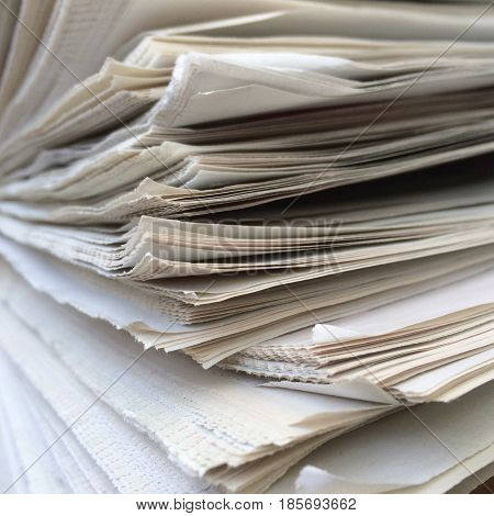 Close up of the edges of a stack of newspapers
