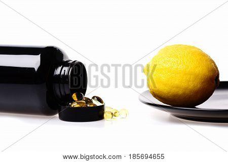 Lemon Fruit And Fish Oil In Black Plastic Bottle
