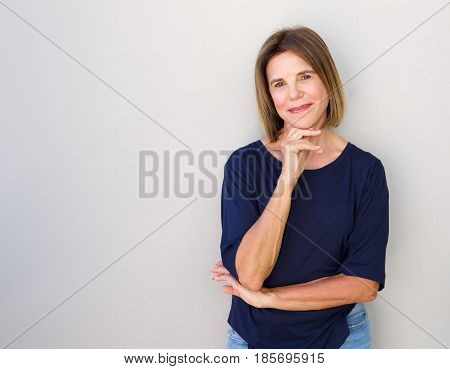 Attractive Older Woman Smiling With Hand To Chin