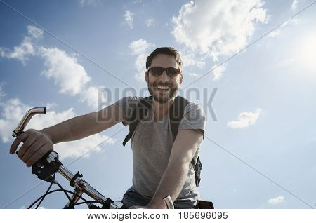 Man with bicycle having fun. Retro style image.