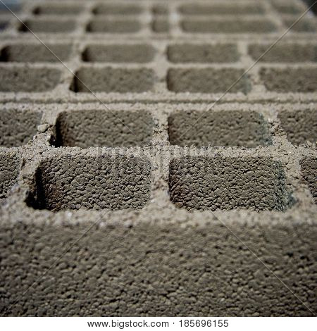 Fresh perpends aligned drying on the ground, breeze block
