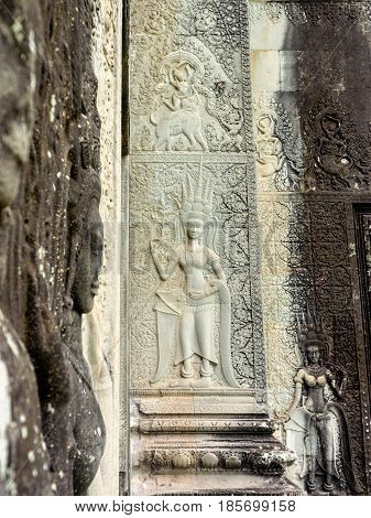 Stone carving of an angel or Apsara on the wall of Angkor Wat the ancient Hindu temple complex in Cambodia