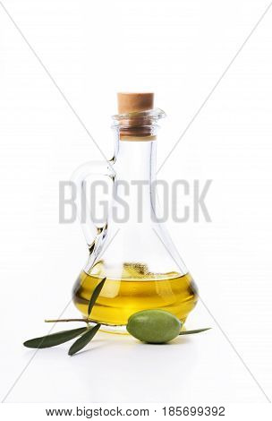 Olive oil bottle and fresh olive isolated over white background