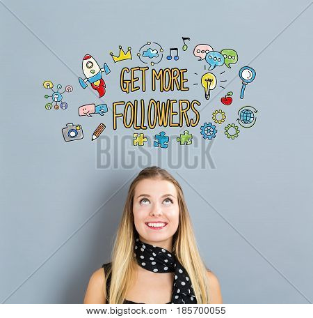 Get More Followers concept with happy young woman on a gray background