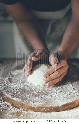Man baking bread in the kitchen. Retro style.