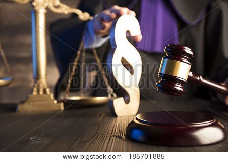 Law - judge in toga with the gavel during trial